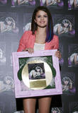 th 63025 SelenaGomezacceptsagoldrecordforheralbumWhenTheSunG 0036 123 229lo Selena Gomez   Receives gold record for When The Sun Goes Down, Four Seasons Hotel, Jan. 26, 2012