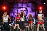 Nicole Scherzinger and the Pussycat Dolls in reveling outfit showing their bodies perform on Operation MySpace live concert in Camp Buehring in Kuwait